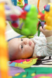 Baby on playing mat Stock Photos