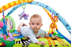 Baby playing on mat Royalty Free Stock Photo