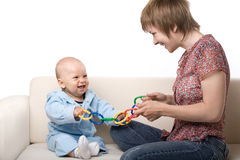 Baby playing with mother stock image