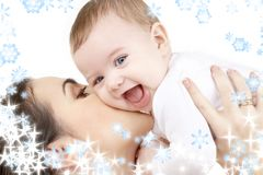 Baby playing with mother Stock Images