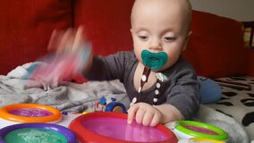 Baby playing music toy. White baby boy playing musical toy drums stock footage