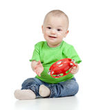 Baby playing with musical toy Stock Photography
