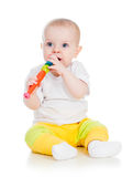Baby playing with musical toy Stock Photo
