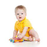 Baby playing with musical toy. Kid playing with musical toy isolated on white stock photos