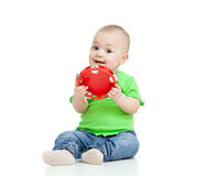 Baby playing with musical toy on white stock images