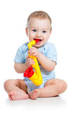 Baby boy playing toy Royalty Free Stock Image