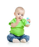 Baby playing with musical toys. On white background stock images