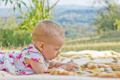 Baby playing outdoor Royalty Free Stock Image