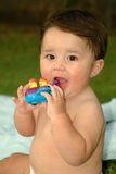 Baby Playing Outside. Hispanic baby boy playing outside and sitting on a blanket Royalty Free Stock Photography