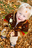 Baby Playing Outside in Falling Leaves Royalty Free Stock Photo