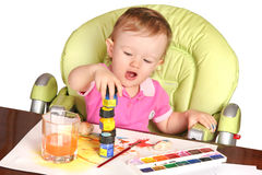 Baby playing with a paints Stock Photos