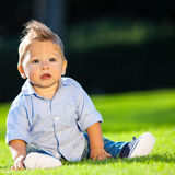 Baby playing on the grass Stock Photo