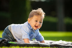 Baby playing on the grass Royalty Free Stock Images