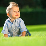 Baby playing on the grass Royalty Free Stock Photos