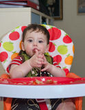 Baby playing with pasta Stock Photos