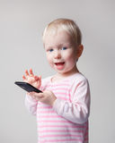 Baby playing phone Royalty Free Stock Photos