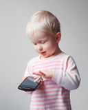 Baby playing phone Royalty Free Stock Photo