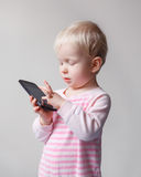 Baby playing phone Stock Photo