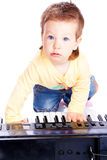 Baby playing piano Stock Photo