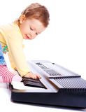 Baby playing piano stock image
