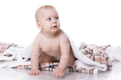 Baby playing on plaid Royalty Free Stock Photos