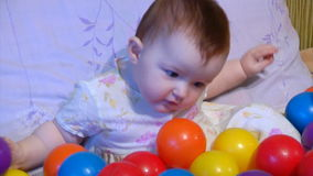Baby playing with plastic balls Stock Photos