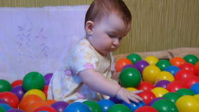 Baby playing with plastic balls Stock Photography