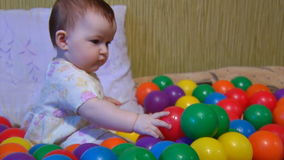 Baby playing with plastic balls Royalty Free Stock Photography