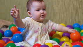 Baby playing with plastic balls Royalty Free Stock Image