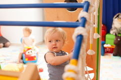 The baby playing on the playground Stock Photos
