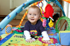 Baby playing on playmat Royalty Free Stock Image