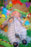 Baby Playing on Playmat Stock Photos