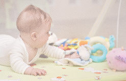 Baby playing in playpen. Baby girl playing in playpen, seen through the mesh Royalty Free Stock Photos