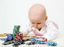 Baby playing poker chips Royalty Free Stock Image