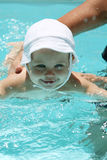 Baby playing in the pool Royalty Free Stock Image