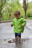 Baby playing in puddles Royalty Free Stock Image