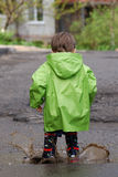 Baby playing in puddles. Small boy playing in puddles Royalty Free Stock Images