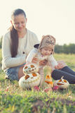 Baby playing with pumpkins Stock Photos