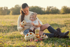 Baby playing with pumpkins Royalty Free Stock Images