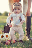 Baby playing with pumpkins Stock Photo