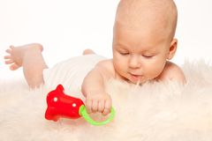 Baby playing with rattle Stock Photo