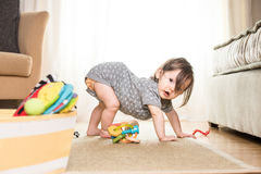 Baby Playing on Rug Stock Photos