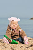Baby playing sand. Baby playing in sand on the beach Stock Images