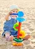 Baby playing with sand. On the beach Royalty Free Stock Photo