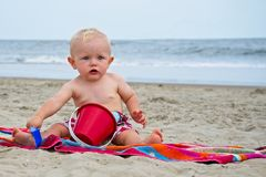 Baby Digging in Sand on Virginia Beach Virginia`s Beach. Baby Playing With Sand Bucket and Shovel on the Beach in Virginia Beach, Virginia Royalty Free Stock Photography