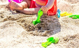 Baby playing in the sand Royalty Free Stock Photo