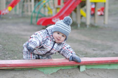 Baby playing with sand on playground. Baby age of 1 year playing with sand on playground Stock Photography