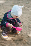 Baby playing in a sandpit Royalty Free Stock Image
