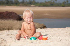 Baby playing on the sea coast Royalty Free Stock Image