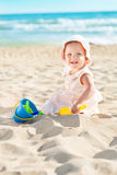 Baby playing at the sea Stock Images